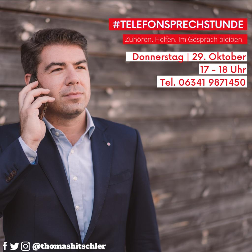 Thomas Hitschler mit Smartphone am Ohr zur Bewerbung der Bürgersprechstunde